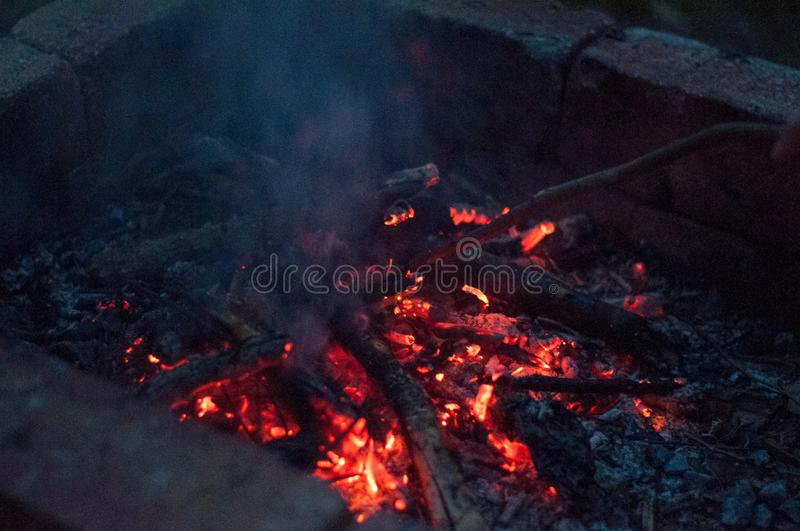 Closeup top-down shot of fire embers at night stock image