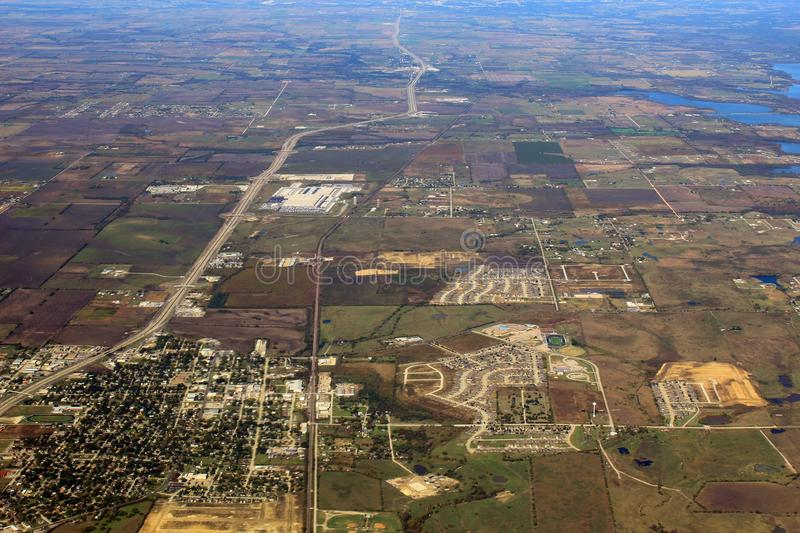 Image captured from a window of a commercial airplane while flying over western United States. Urban area royalty free stock images