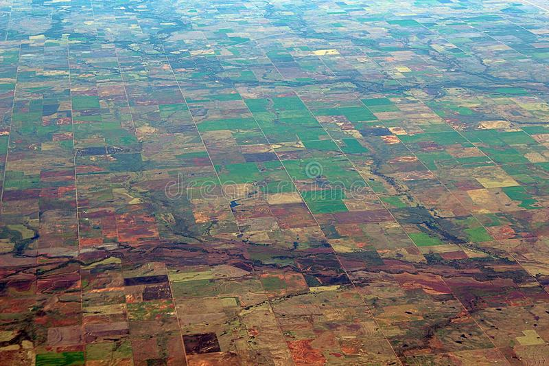 Image captured from a window of a commercial airplane while flying over western United States. Urban area royalty free stock photos