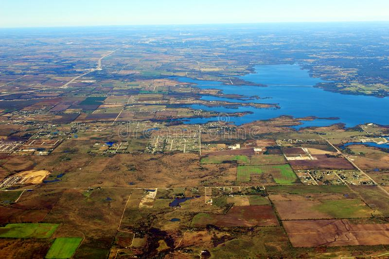 Image captured from a window of a commercial airplane while flying over western United States. Urban area stock photos