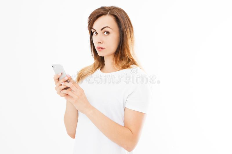 Image of cheerful cute beautiful young woman chatting by mobile phone isolated over white background. Looking at camera stock photo