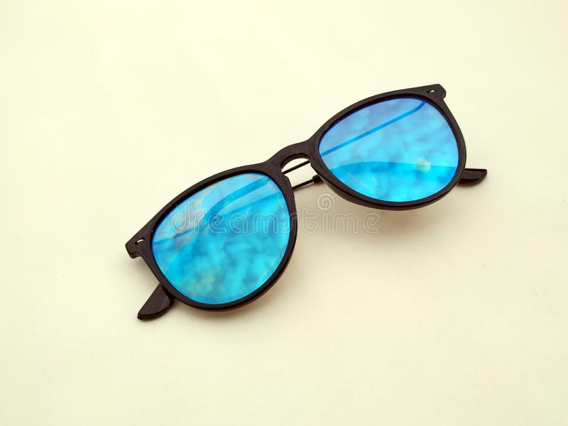 Children sunglasses, sun shades or spectacles  onyellow background. Color child glasses protection from sun and UV rays. C stock photo