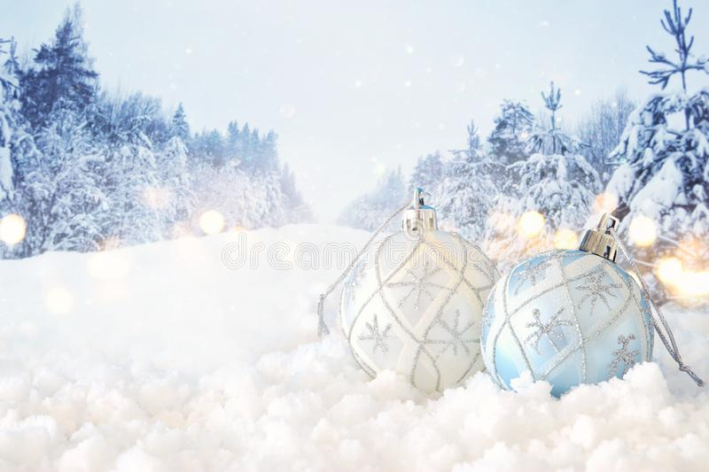 Image of christmas festive tree white ball decoration in front of magical winter landscape background. Image of christmas festive tree white ball decoration in stock photo