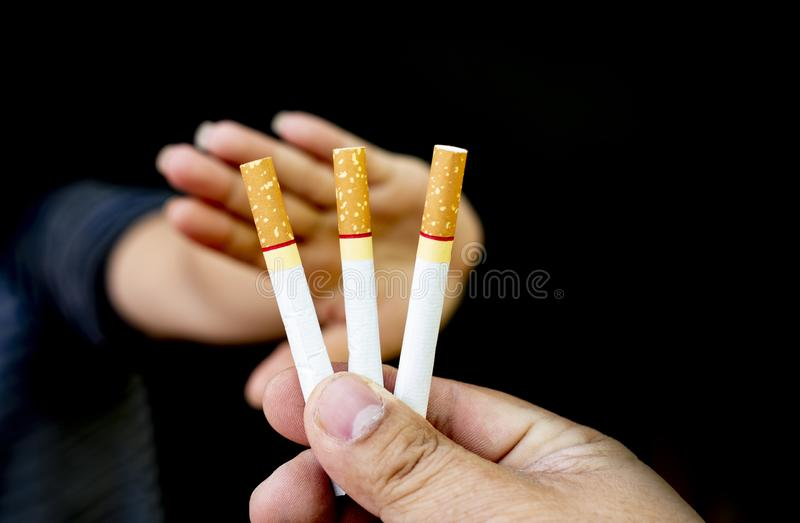 Image of cigarette in hand, Stop smoking concept, World No Tobacco Day ,Smoking does not hurt you alone It also hurts the people a. Round you and everyone in royalty free stock images
