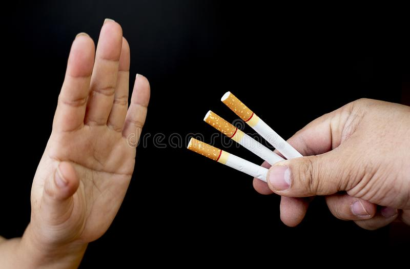 Image of cigarette in hand, Stop smoking concept, World No Tobacco Day ,Smoking does not hurt you alone It also hurts the people a. Round you and everyone in royalty free stock photography
