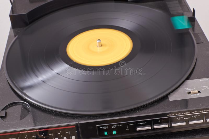 Classic lp disc player with moving disc royalty free stock image