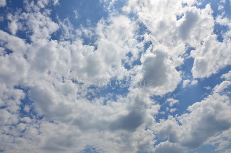 Image of clear blue sky and white clouds on day time for background usag. E royalty free stock image