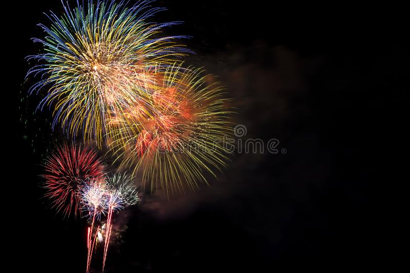 Fireworks Bursting in Night Sky with Copyspace royalty free stock photography