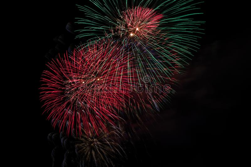 Fireworks Bursting in Night Sky with Copyspace stock photo