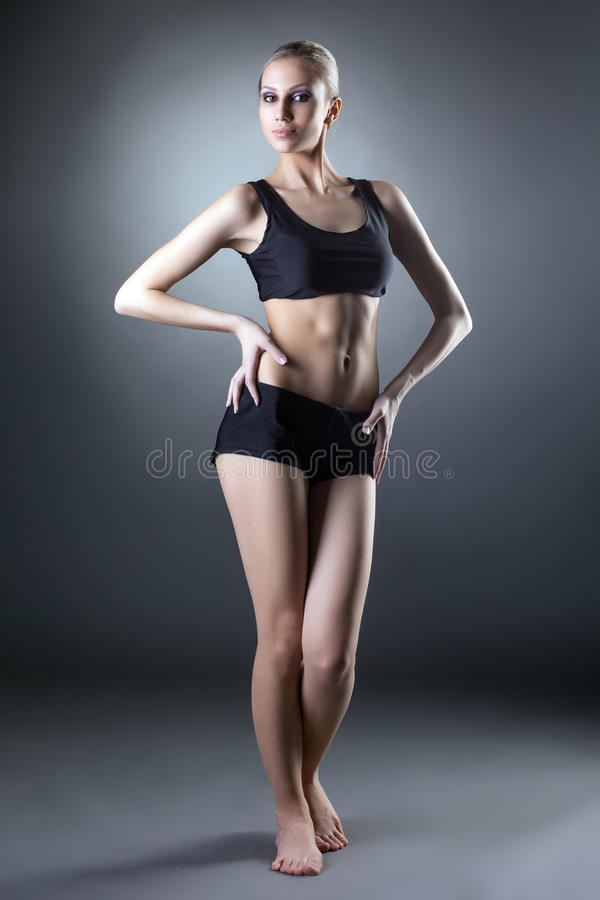 Image of comely sporty woman posing at camera. Studio shot of comely sporty woman posing at camera stock photos