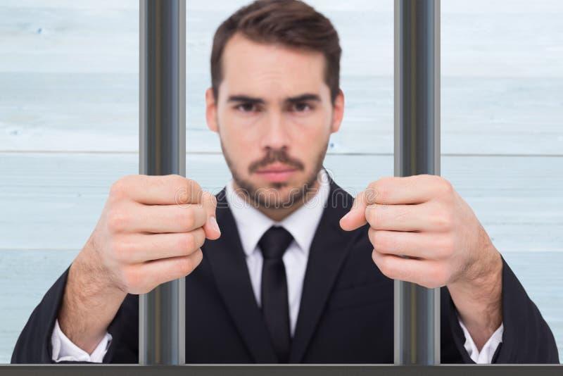 Image composée d'homme d'affaires exaspéré avec les poings serrés photographie stock