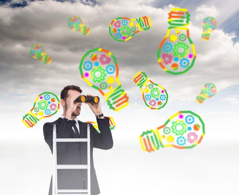 Image composée d'homme d'affaires regardant sur une échelle images libres de droits