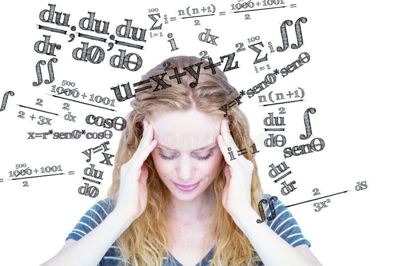 Image composée d'une femme blonde ayant le mal de tête photos stock