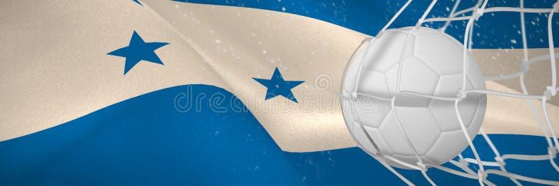 Image composée de ballon de football dans le filet de but illustration libre de droits