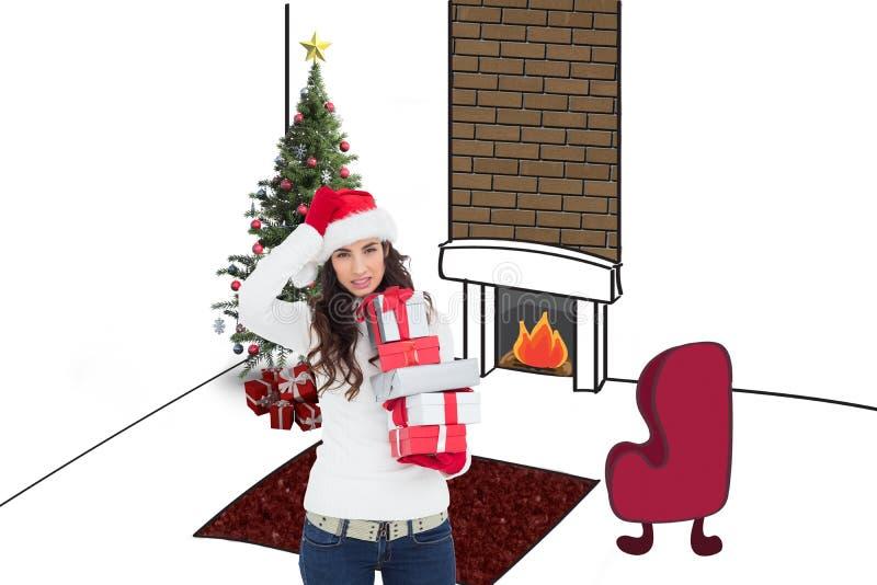 Image composée de brunnette soumis à une contrainte dans le chapeau de Santa tenant des cadeaux photo stock