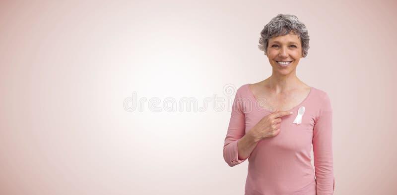 Image composée de femme dans des équipements roses montrant le ruban pour la conscience de cancer du sein photos stock