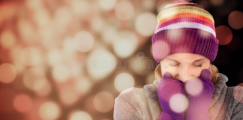 Image composée de femme de gel avec des gants et un chapeau photo libre de droits