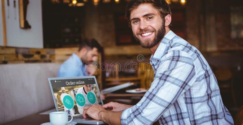 Image composée de jeune homme travaillant sur son ordinateur images libres de droits