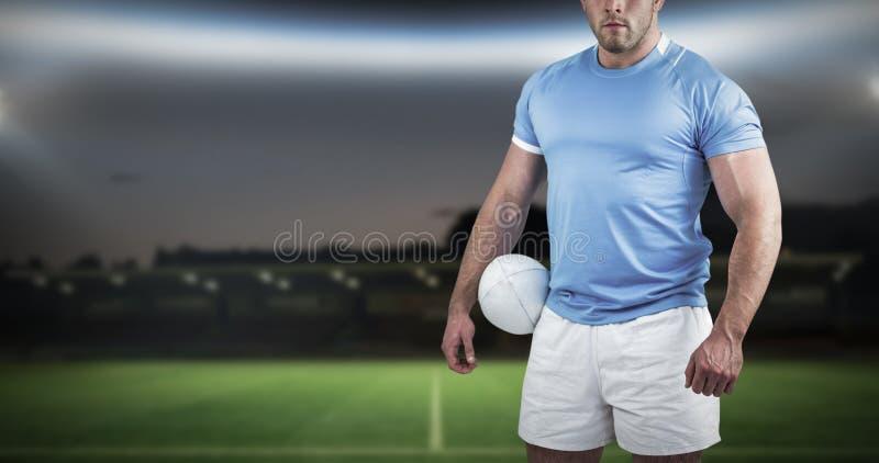 Image composée de joueur de rugby regardant l'appareil-photo images stock