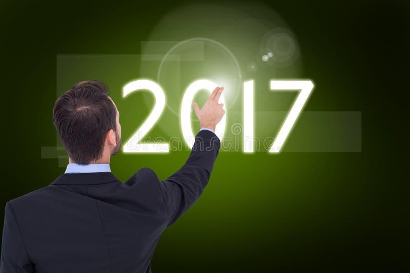 Image composée de l'homme d'affaires dans le costume dirigeant ces doigts photo stock