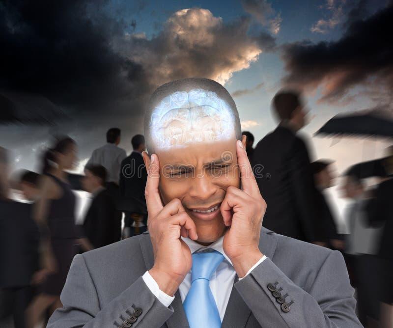 Image composée de l'homme d'affaires soumis à une contrainte mettant ses doigts sur ses temples photos libres de droits