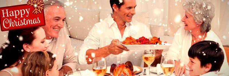 Image composée de la famille dînant grand à la maison photo stock