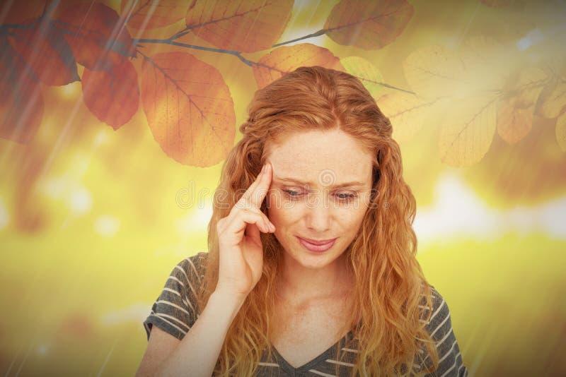 Image composée de la femme blonde ayant le mal de tête photo stock