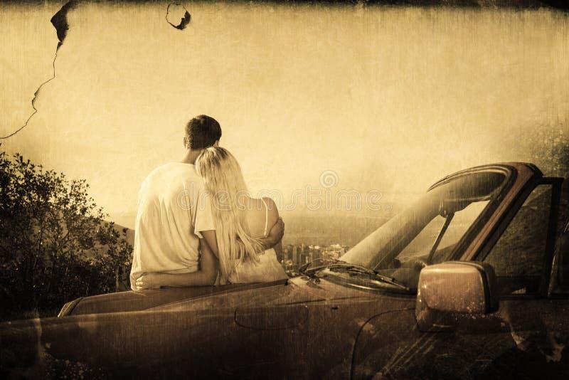 Image composée de la vue arrière d'étreindre de couples et de panorama admiratif illustration stock