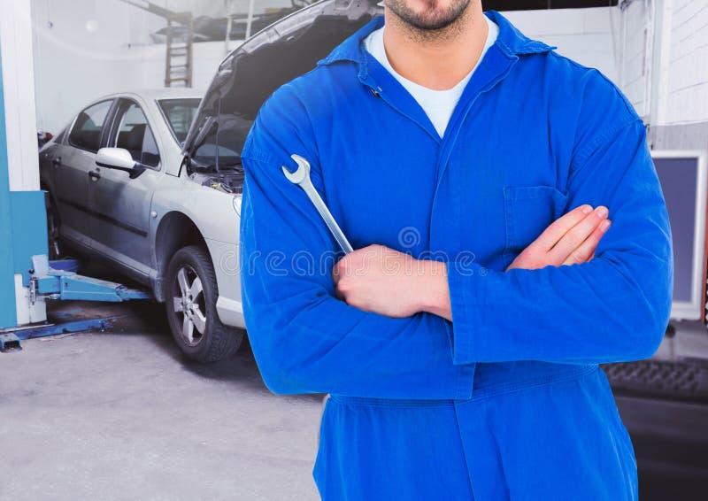 Image composée de mécanicien de voiture tenant la clé illustration stock