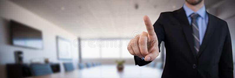 Image composée de mi section d'homme d'affaires dans le costume sélectionnant au-dessus de l'interface invisible images libres de droits