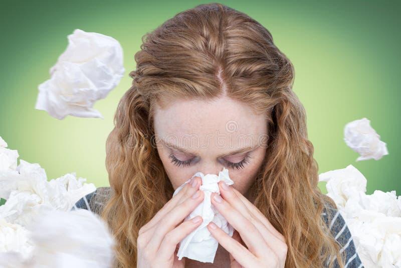 Image composée de plan rapproché de nez de soufflement de femme dans le tissu image stock