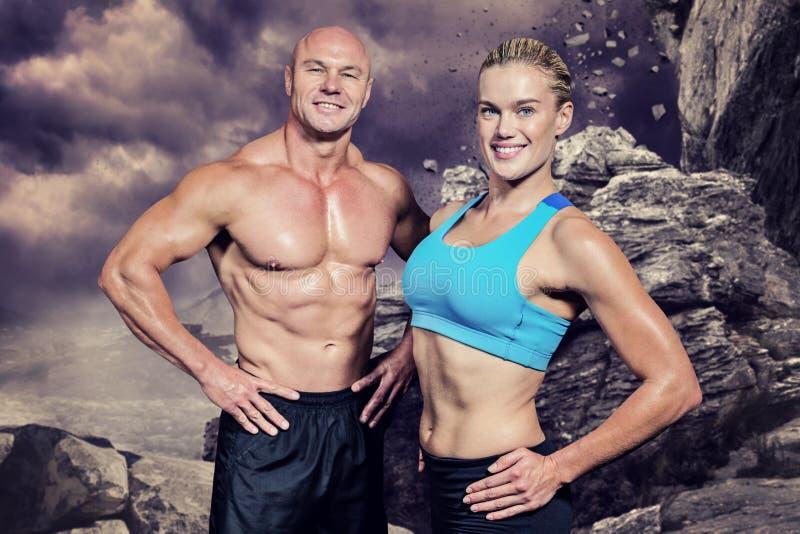 Image composée de portrait d'homme et de femme heureux avec la main sur la hanche images stock