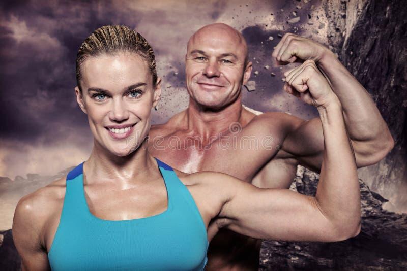 Image composée de portrait d'homme sûr et de femme gais fléchissant des muscles image libre de droits