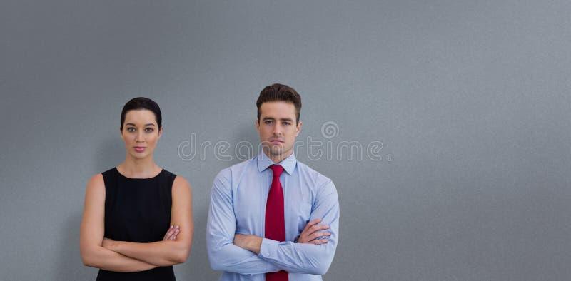 Image composée des collègues d'affaires posant avec les bras croisés photographie stock libre de droits