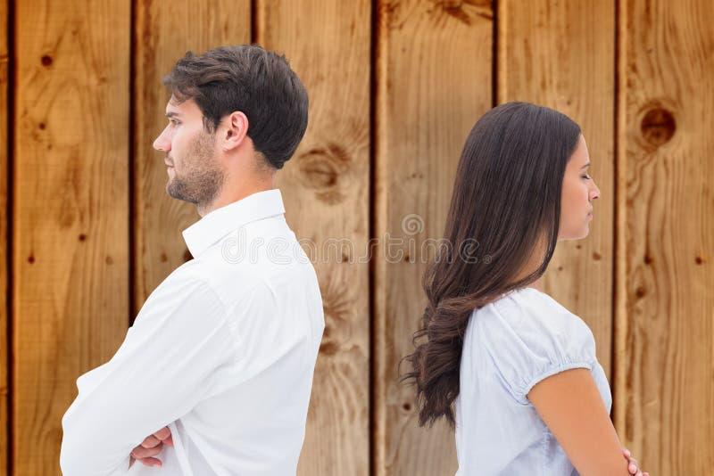 Image composée des couples de renversement ne parlant pas entre eux après combat photographie stock