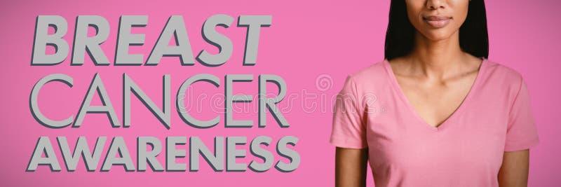 Image composée des femmes dans la position rose pour le cancer du sein photographie stock