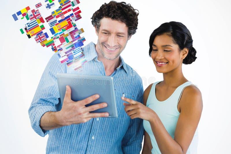 Image composée des gens d'affaires de sourire à l'aide du comprimé numérique photo libre de droits