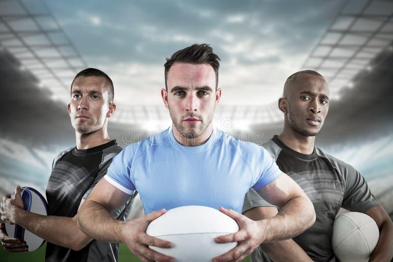 Image composée des joueurs durs 3D de rugby images stock