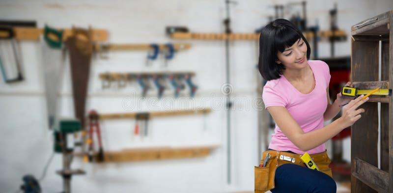 Image composée des meubles de mesure de femme avec le ruban métrique photos stock