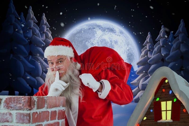 Image composée du père noël avec le doigt sur des lèvres se tenant près de la cheminée images stock