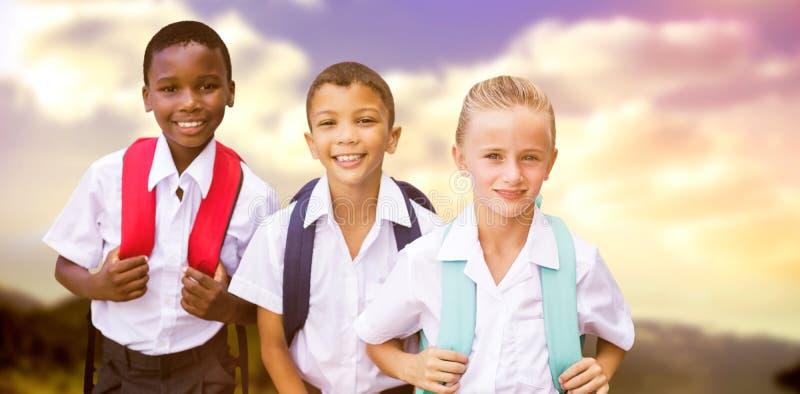 Image composée du portrait des étudiants dans des uniformes photos stock
