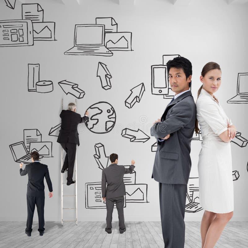 Image composée du portrait des gens d'affaires se tenant dos à dos images libres de droits