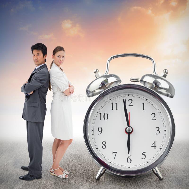 Image composée du portrait des gens d'affaires se tenant dos à dos images stock