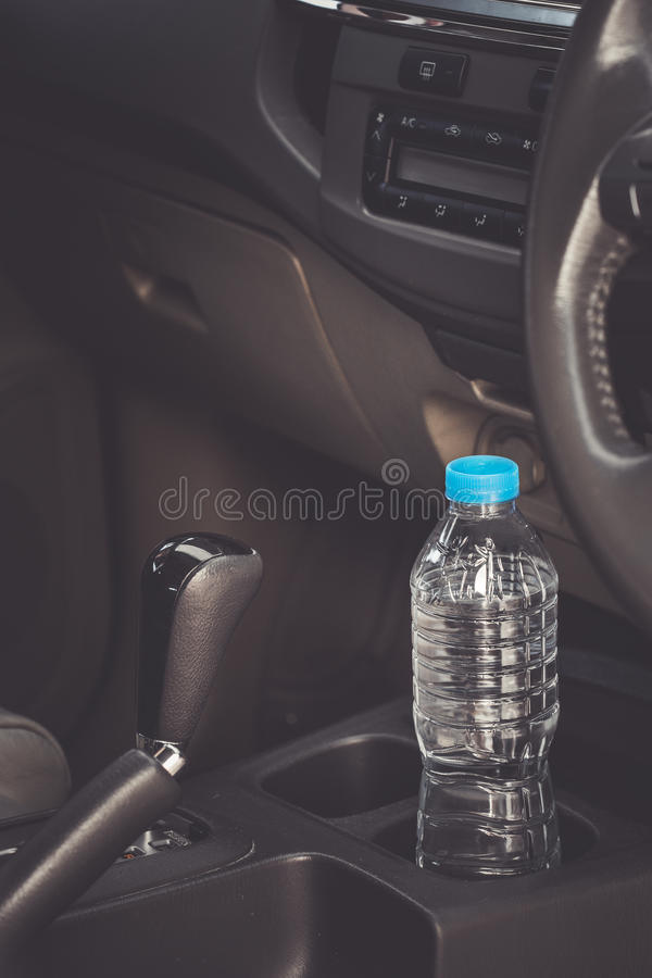 Image concept Bottled water was left in the car for a long time. To drink it? . Image concept Bottled water was left in the car for a long time. To drink it royalty free stock images