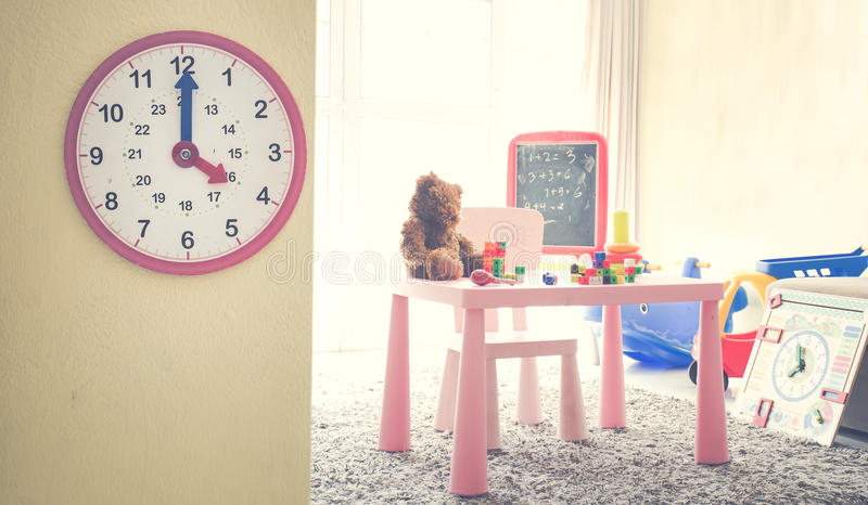 Image Concept Toys to play with time/ Interior of colorful playing room for kids.  royalty free stock photo