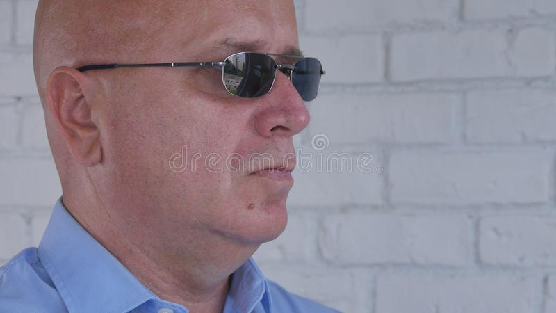 Image with a Confident Businessman Wearing Sunglasses. Image with a Confident Businessman in Office Wearing Black Sunglasses stock images