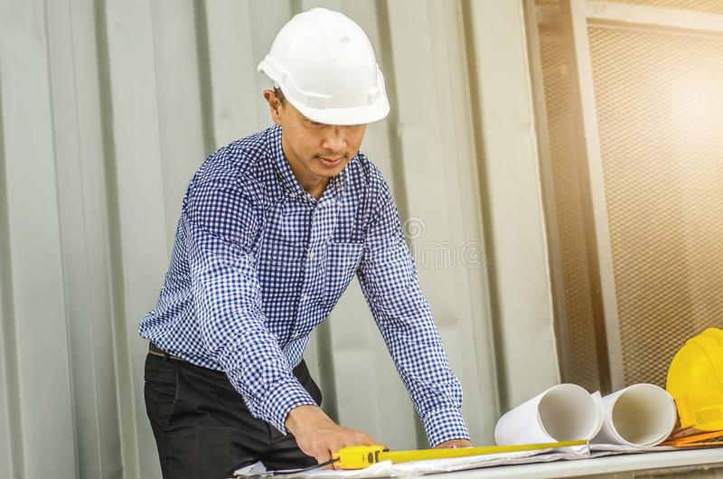 Image of constructor sketching plans together and drawing tools stock photos