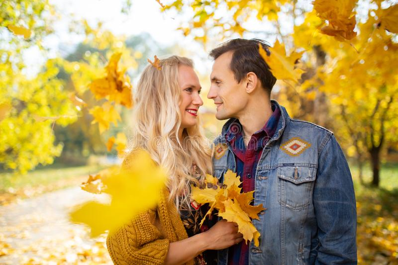 Image of couple in love at autumn forest royalty free stock photography