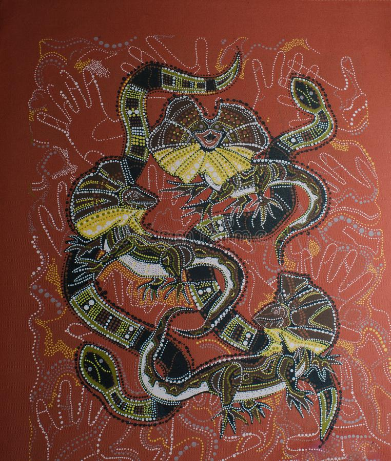 A stylized design of three izards and two snakes stock photography