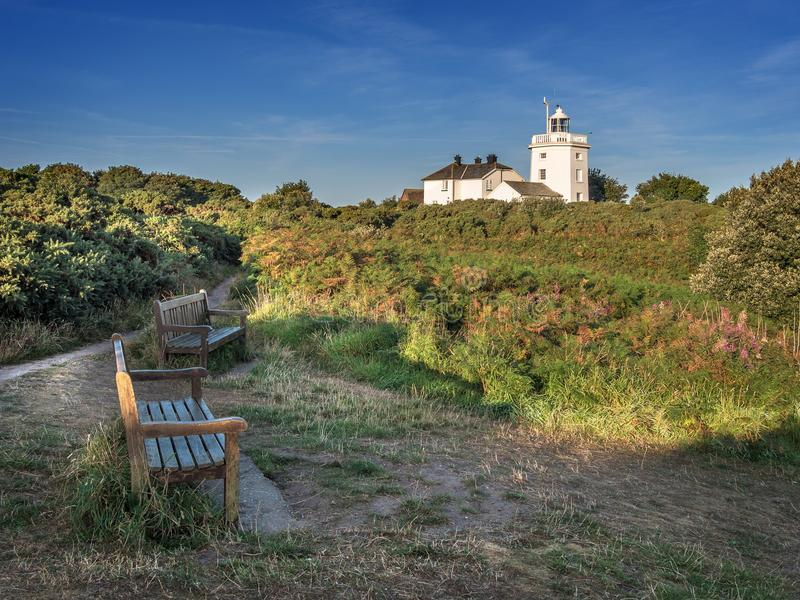 Cromer Lighthouse. Image of Cromer Lighthouse with footpath and benches in the foreground Norfolk royalty free stock images